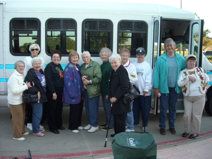 people boarding bus for day trip with Senior Center